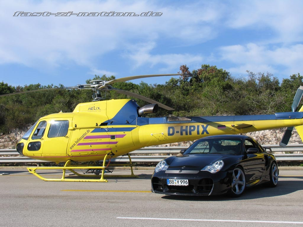 Porsche 911 (996) Cabriolet by TechArt (in front of a helicopter) - desktop wallpaper in 1024x768