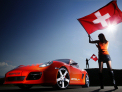 Girl with Swiss flag and Porsche Cayman by Rinsspeed
