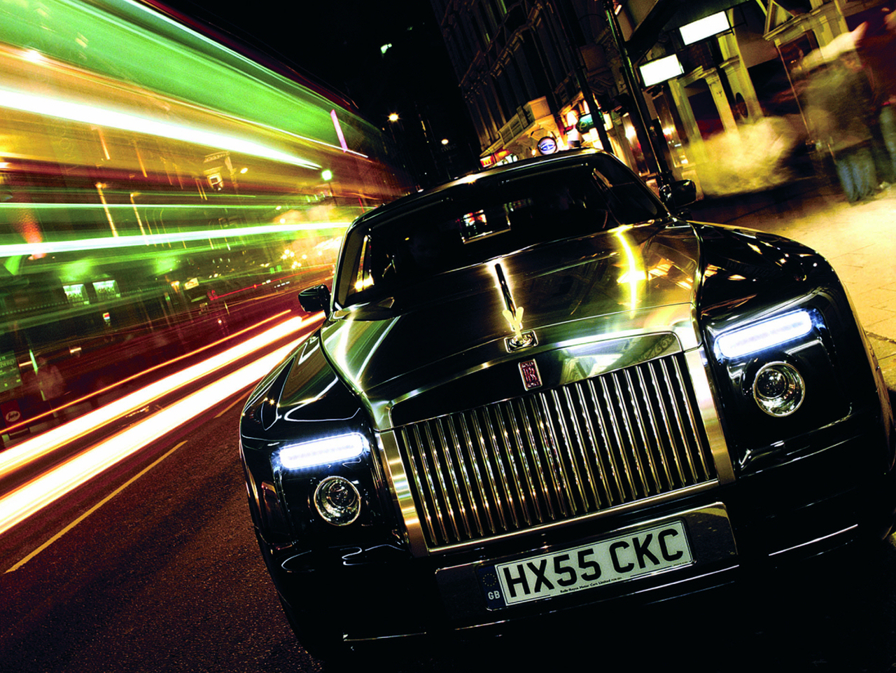 Rolls Royce Phantom reflects the city lights