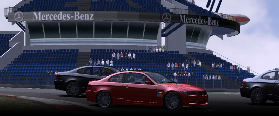 M3s pass the grandstand at Nürburgring